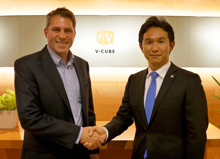 Scott Wharton, General Manager of Logitech's Video Collaboration Group and Naoaki Mashita, CEO & founder of V-cube, Inc.